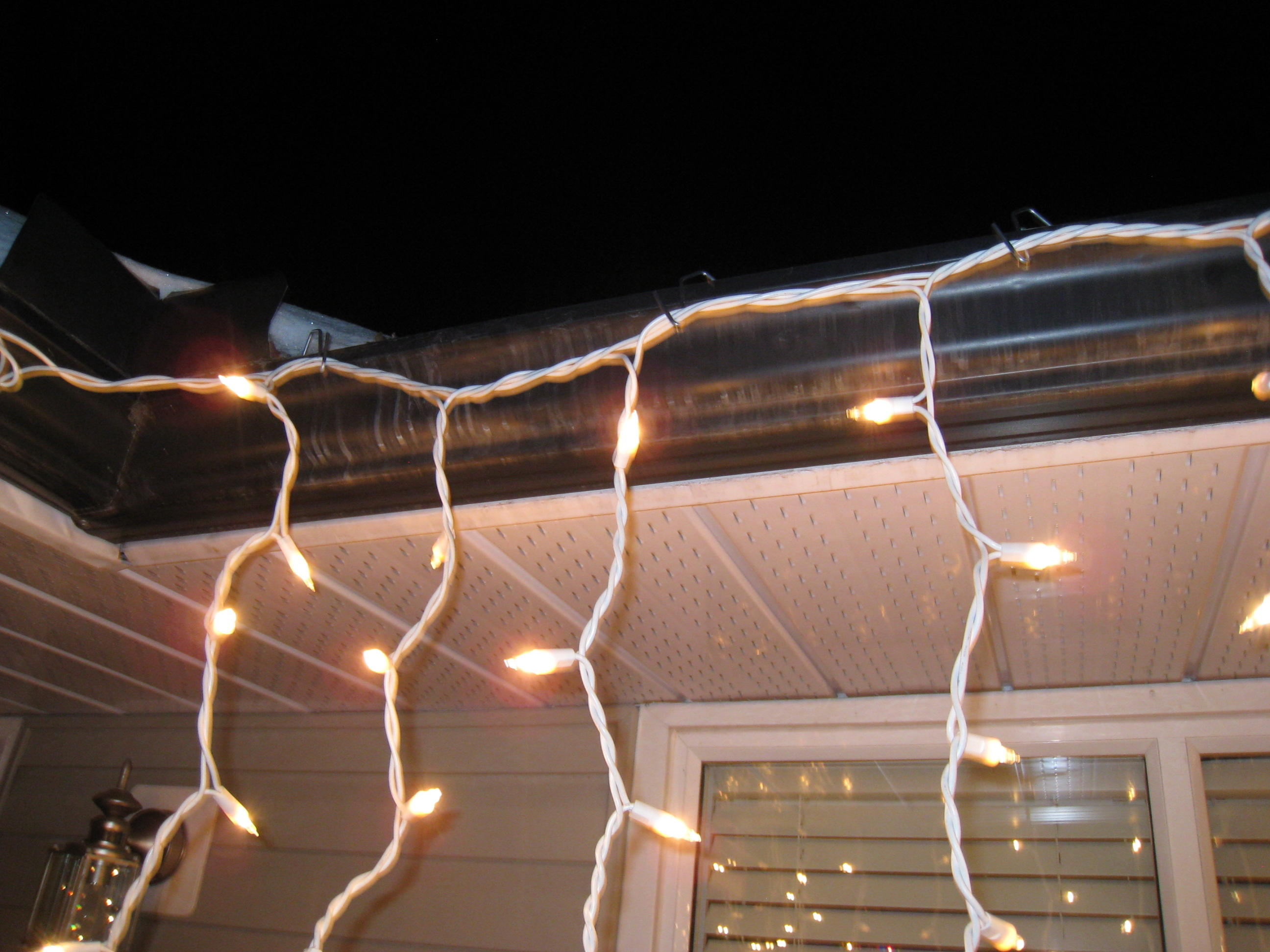 christmas light hangers for gutters with mesh or perforated gutter guard testimonies